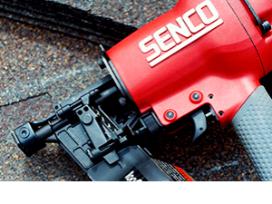 A Senco Tools Pneumatic Air Nailer laying on some shingles.